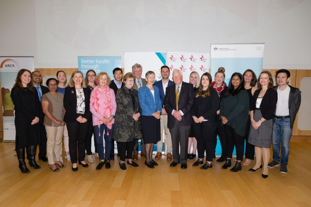 A group of ASPREE researchers and participants stand together at the ACTA Clinical Trial of the Year Award ceremony